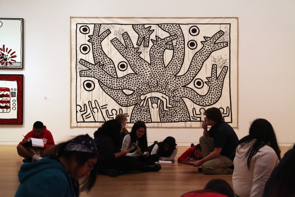 Keith Haring, Untitled, 1982 (installation view). Sumi ink on paper. 107 x 160 inches. Collection of Scott and Yael Braun. Keith Haring artwork © Keith Haring Foundation.